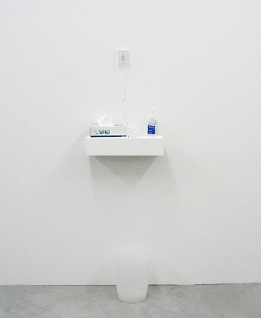 Installation, mixed media: ipod shuffle with soundcollage, earphones, packaging, <br>handsanitizer, papertowel dispenser, trash can
