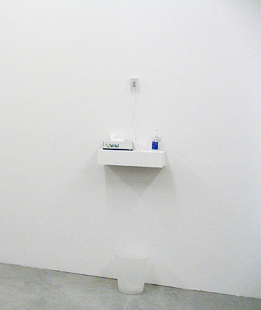 Installation, mixed media: ipod shuffle with soundcollage, earphones, packaging,<br> handsanitizer, papertowel dispenser, trash can